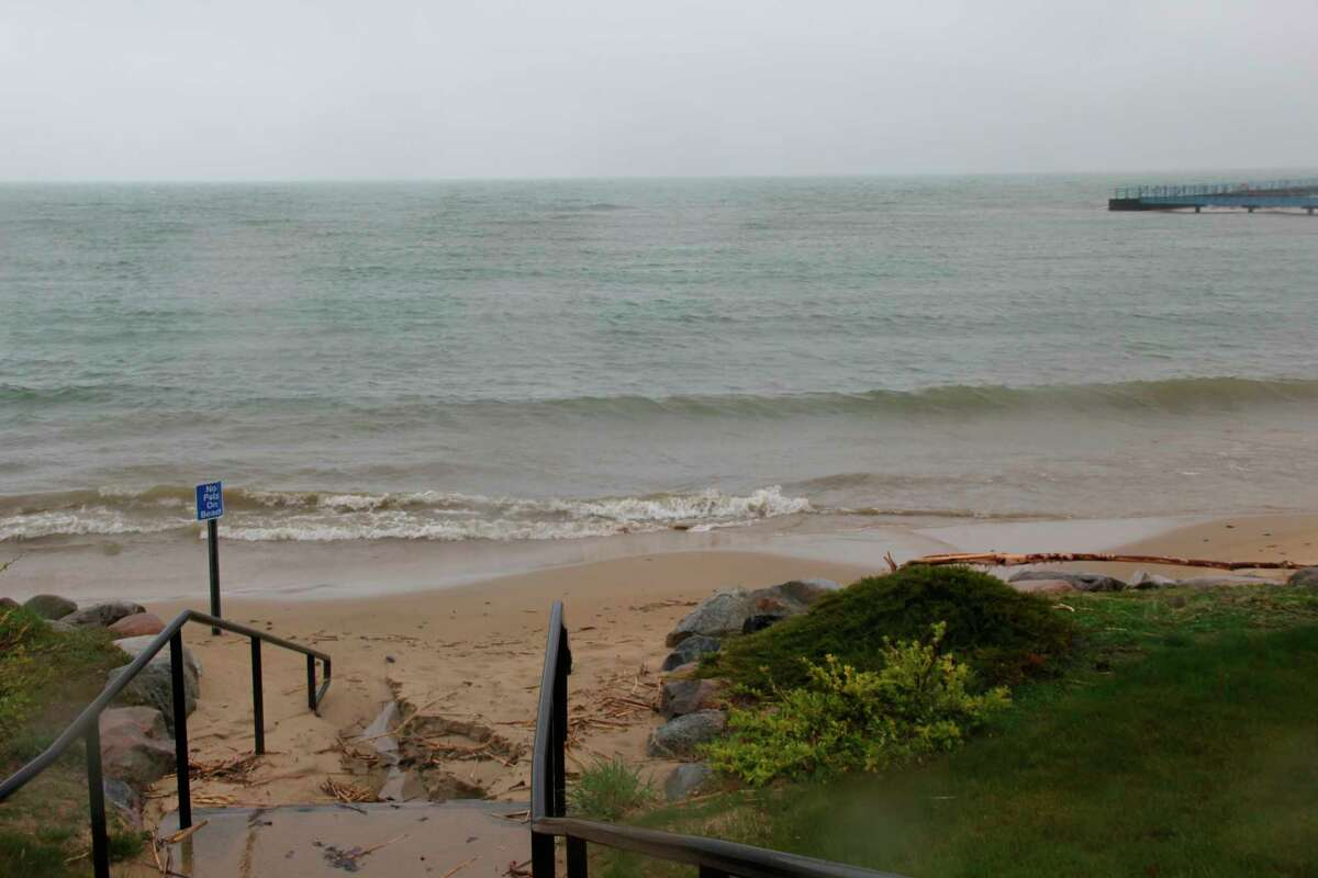 The Port Austin shoreline during heavy rainfall in May. Lake Huron set a new mean water level for July and is expected to do so again in August. (Tribune File Photo)