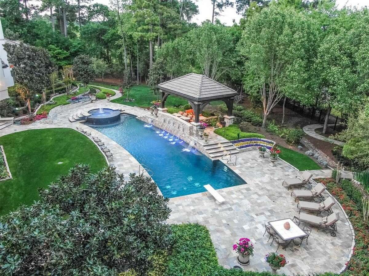 51 Grand Regency Circle in The Woodlands: There's a little of everything in this suburban paradise.