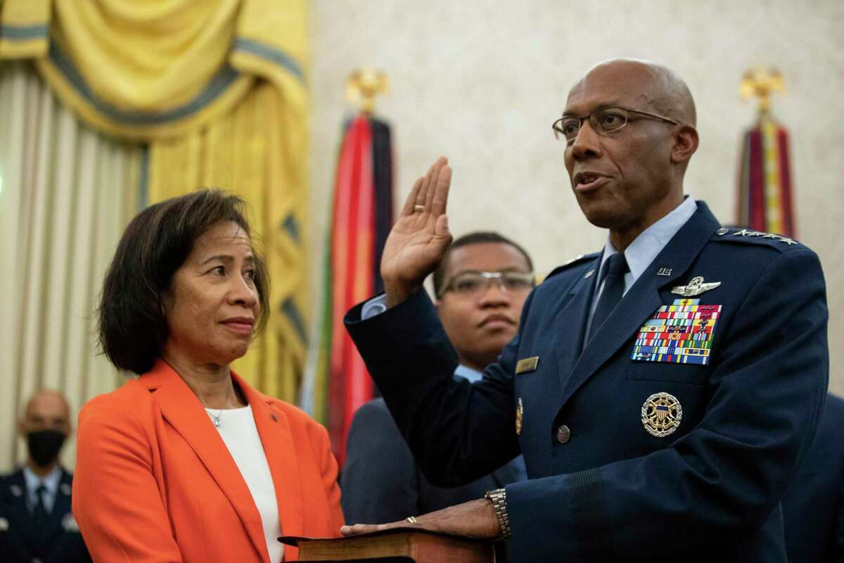 Gen. Charles Q. Brown Jr., was sworn in Tuesday at the Oval Office as chief of staff of the Air Force as his wife Sharene Guilford Brown, holds a bible. His installation ceremony was Thursday.