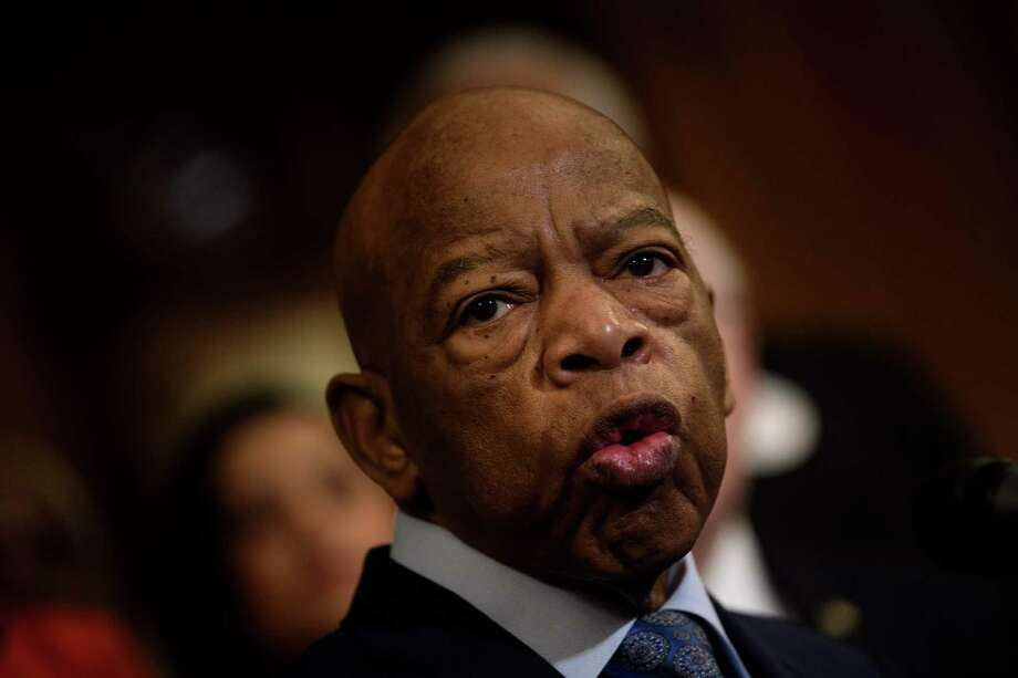 """(FILES) In this file photo taken on December 6, 2019 Rep. John Lewis (D-GA) speaks during a press conference about voting rights on Capitol Hill in Washington, DC. - US President Donald Trump said he doesn't know how history will remember civil rights activist John Lewis, but that """"he chose not to come to my inauguration,"""" in an interview with US media. A longtime Democratic congressman, Lewis died on July 17, then received rare honors in Washington and was praised by key figures of both major parties for his life-long fight for equality. """"How do you think history will remember John Lewis?"""" Jonathan Swan of the Axios media outlet asked Trump in the interview aired on August 3, 2020.""""I don't know, I really don't know,"""" the president answered.""""I don't know John Lewis, he chose not to come to my inauguration."""" (Photo by Brendan Smialowski / AFP) (Photo by BRENDAN SMIALOWSKI/AFP via Getty Images) Photo: BRENDAN SMIALOWSKI / AFP Via Getty Images / AFP or licensors"""