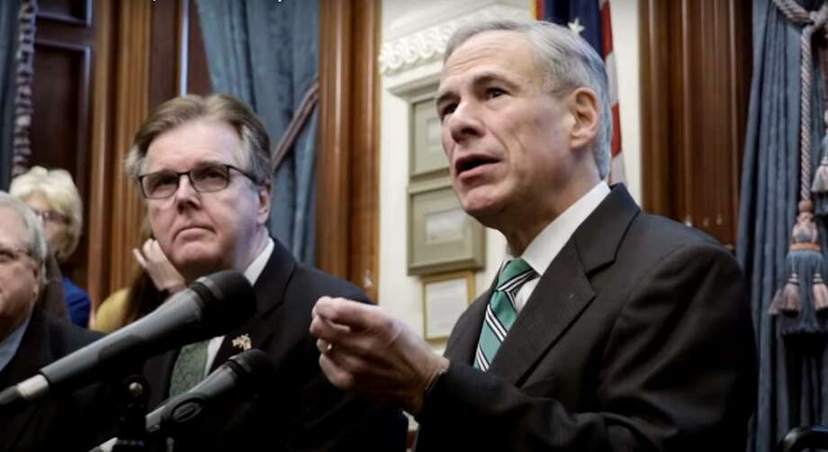 Governor Greg Abbott (right), flanked by Lt. Gov. Dan Patrick, speaks at a COVID-19 press conference in the spring of 2020. Photo: Courtesy Office Of Governor Greg Abbott