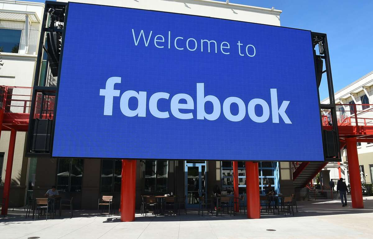"""(FILES) In this file photo taken on October 23, 2019 a giant digital sign is seen at Facebook's corporate headquarters campus in Menlo Park, California. - Facebook on July 31, 2020 added licensed music videos to the social network in the US, challenging YouTube for the attention of online audiences. Facebook said users will be able to """"come together"""" around official music videos, with the promise of premier content from J. Balvin, Karol G, Sebastian Yatra, and other artists. (Photo by Josh Edelson / AFP) (Photo by JOSH EDELSON/AFP via Getty Images)"""