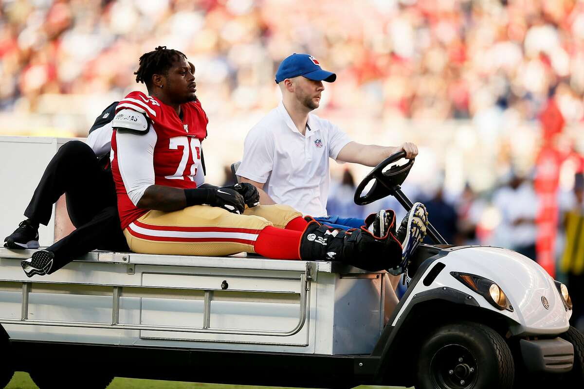 San Francisco 49ers offensive tackle Shon Coleman (78) is carted off the field during an NFL preseason game against the Dallas Cowboys at Levi's Stadium on Saturday, Aug. 10, 2019, in Santa Clara, Calif.