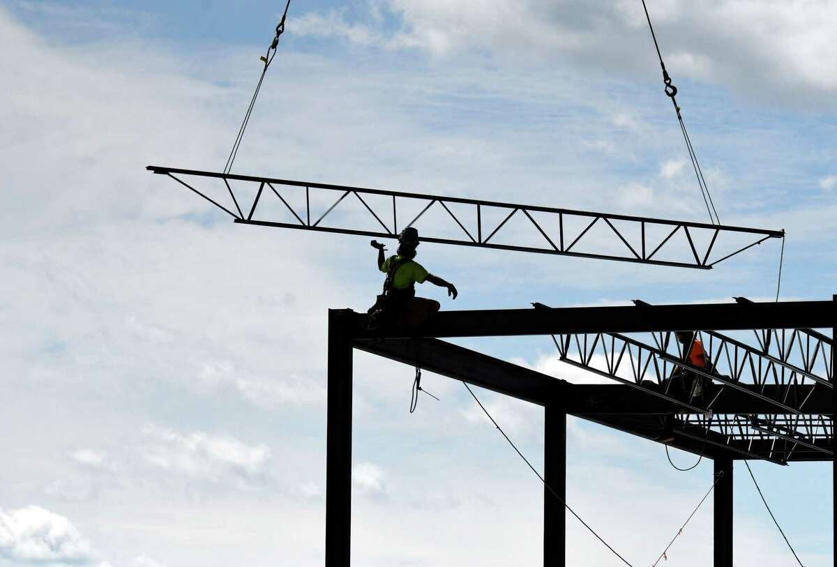 Steel structure for the Starbuck Island apartment complex is lifted into place on Thursday, Aug. 6, 2020, in Green Island , N.Y. (Will Waldron/Times Union)