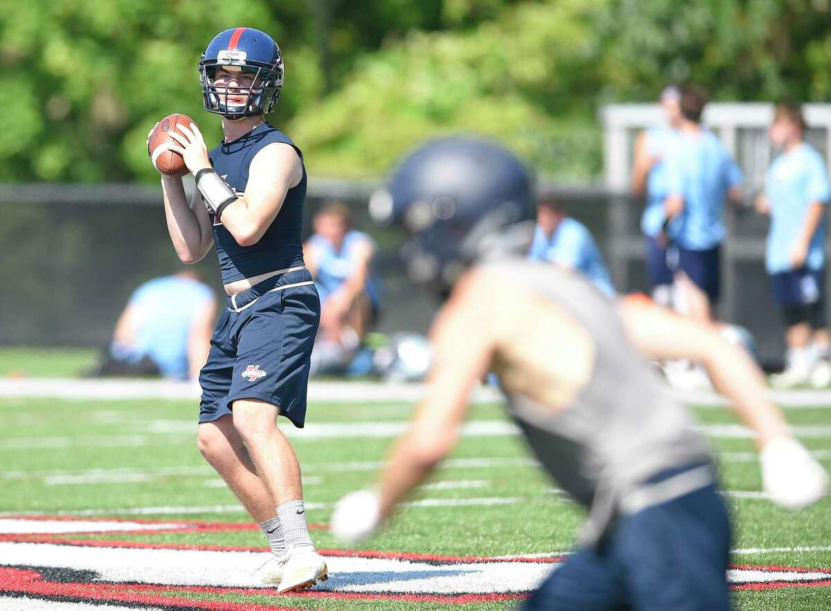 New Fairfield quarterback Matthew Constantinides drops back to pass during the annual Grip It and Rip It 7-on-7 football tournament in New Canaan on July 12, 2019.