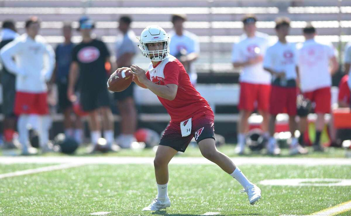 Greenwich quarterback James Rinello drops back to pass during the annual Grip It and Rip It 7-on-7 football tournament in New Canaan on July 12, 2019.