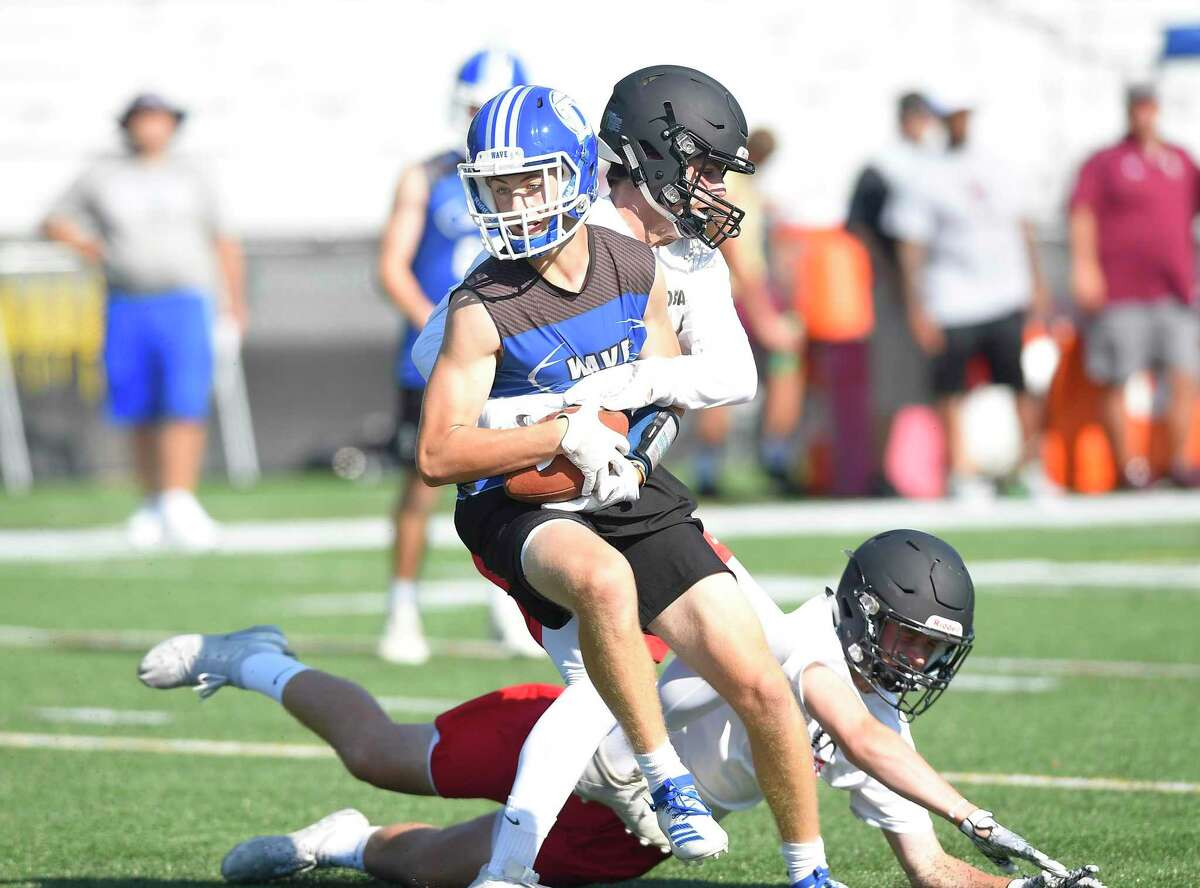 Darien's Oliver Bolton is sacked by a Rye NY defender during the annual Rip It and Grip It tournament on July 12.
