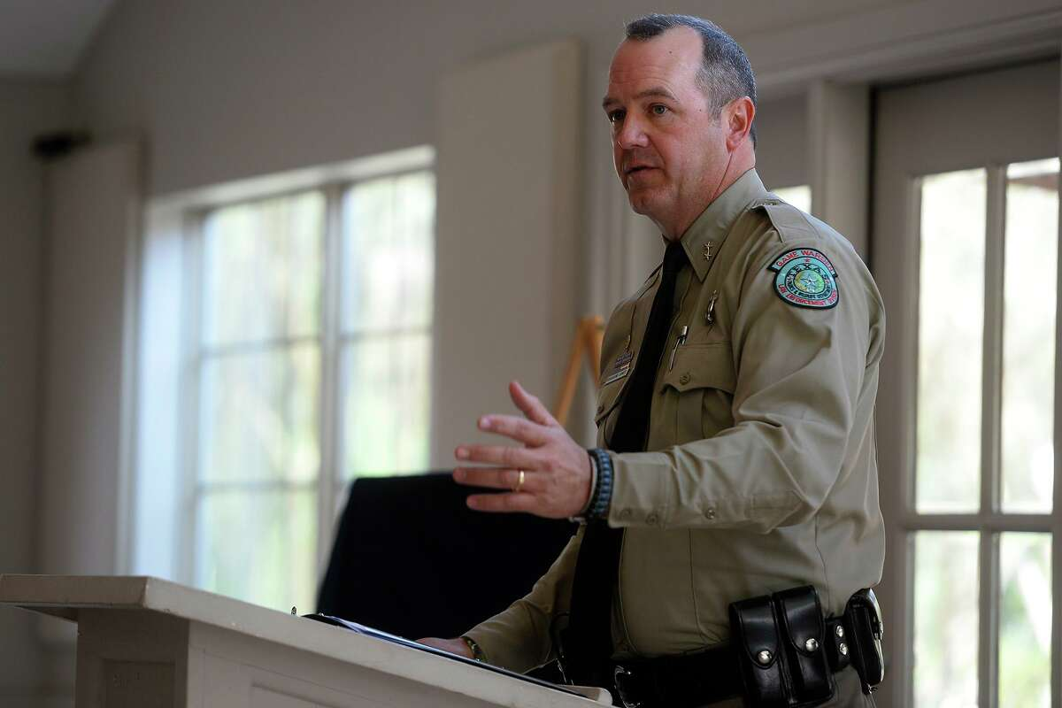 Texas Game Warden Chief Grahame Jones speaks during a ceremony Tuesday unveiling that a section of Texas 87 will be renamed in memory of Game Warden Michael C. Pauling. Photo taken Tuesday 10/25/16 Ryan Pelham/The Enterprise