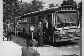 United Traction's President Thomas F. Riedy meets with Albany Mayor Erastus Corning on Washington Avenue opposite City Hall in June 1962. The company was facing a shutdown in 1970. (Bob Wilder/Times Union Archive)