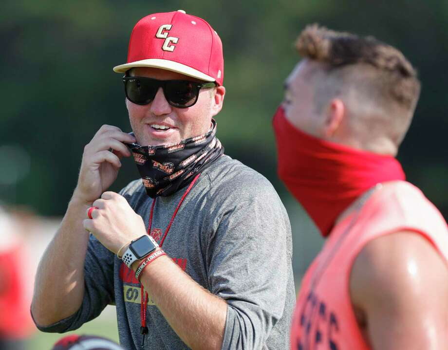 Caney Creek head football coach Kendall Hineman shares a laugh with Brandon Greenshields during the school's strength and conditioning camp, Wednesday, Aug. 5, 2020, in Grangerland. Photo: Jason Fochtman, Houston Chronicle / Staff Photographer / 2020 © Houston Chronicle