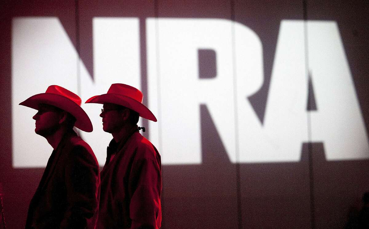 In this May 4, 2013, file photo, National Rifle Association members listen to speakers during the NRA's annual Meetings and Exhibits at the George R. Brown Convention Center in Houston. The NRA announced Friday it has filed for bankruptcy and will seek to incorporate in Texas instead of New York.
