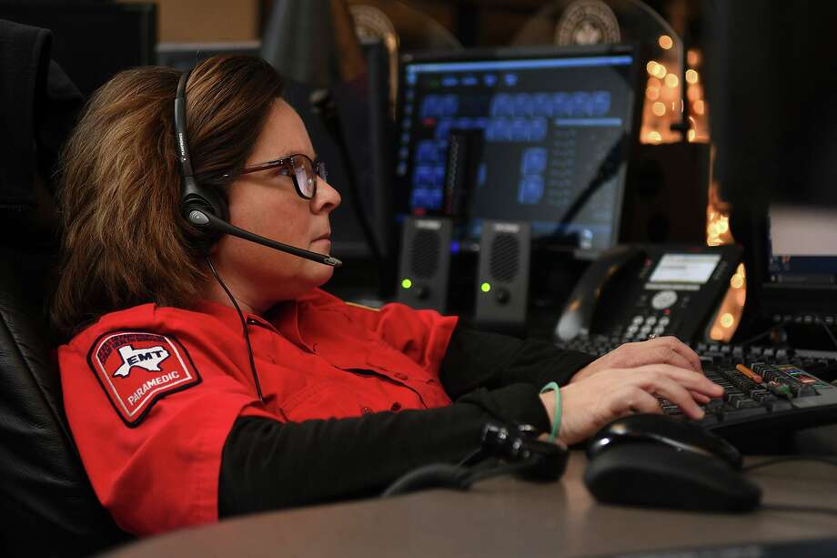 Dispatcher Monica Bryson, of Magnolia, works the Cypress Creek EMS console at the Cypress Creek EMS Comm Center on Dec. 7, 2017. (Photo by Jerry Baker/Freelance) Photo: Jerry Baker, Freelance / For The Chronicle / Freelance