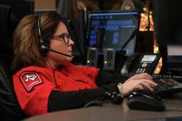 Dispatcher Monica Bryson, of Magnolia, works the Cypress Creek EMS console at the Cypress Creek EMS Comm Center on Dec. 7, 2017. (Photo by Jerry Baker/Freelance)