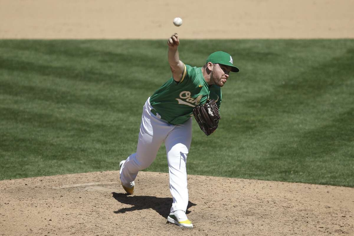 Oakland Athletics pitcher Liam Hendriks works against the Texas Rangers in the ninth inning of a baseball game Thursday, Aug. 6, 2020, in Oakland, Calif. (AP Photo/Ben Margot)