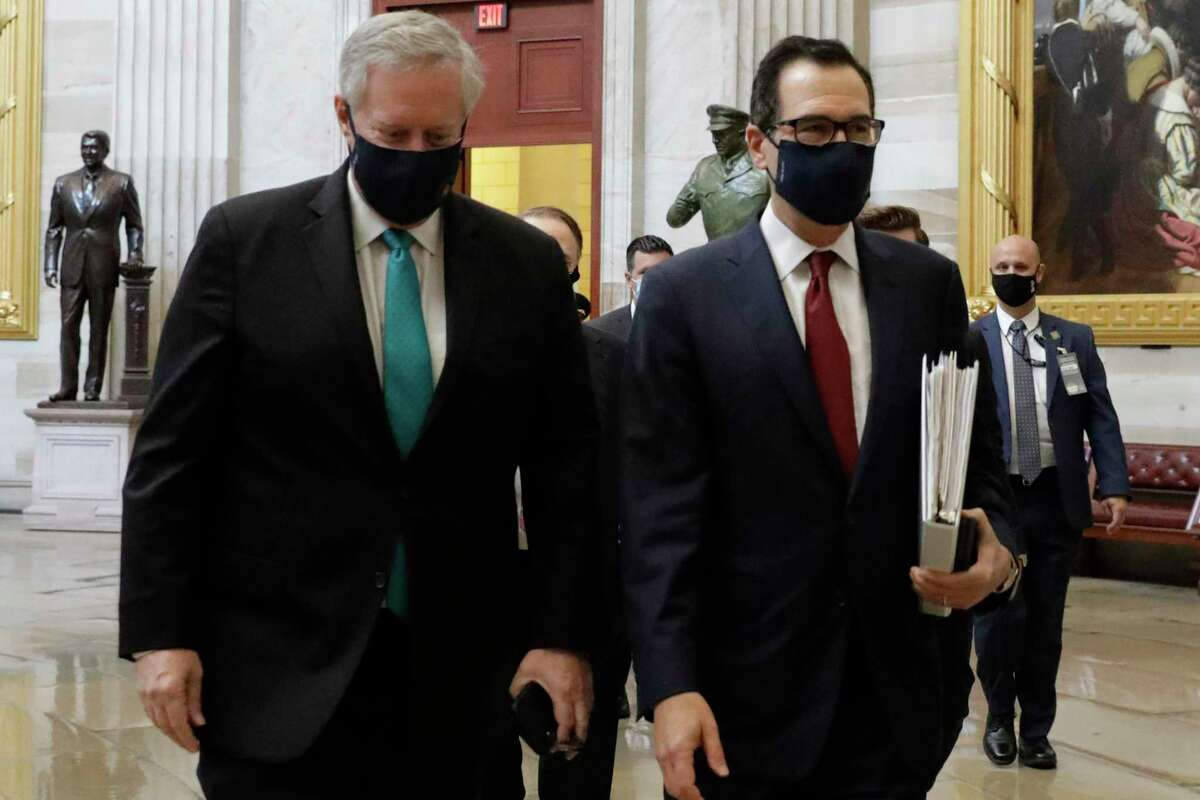 U.S. Treasury Secretary Steve Mnuchin (C) and White House Chief of Staff Mark Meadows arrive to meet with House Speaker Nancy Pelosi (D-CA) and Senate Minority Leader Chuck Schumer (D-NY) on Capitol Hill in Washington on August 5, 2020 in an attempt to reach a deal on a new COVID relief bill.