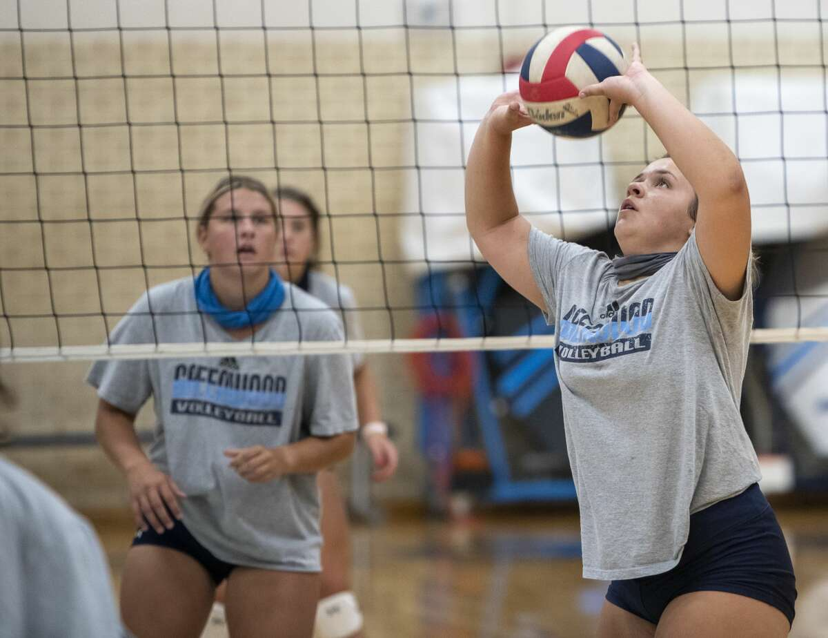 Greenwood's Madison Flores sets the ball Thursday, Aug. 6, 2020 at Greenwood High School. Jacy Lewis/Reporter-Telegram