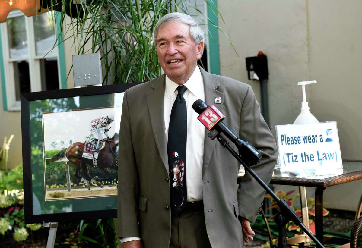 Operating Manager of Sackatoga Stable Jack Knowlton, is interviewed in front of a photo of Tiz The Law at The Siro's Cup Awards presented at Pennell's Restaurant on Thursday, Aug. 6, 2020 in Saratoga Springs, N.Y. (Lori Van Buren/Times Union)