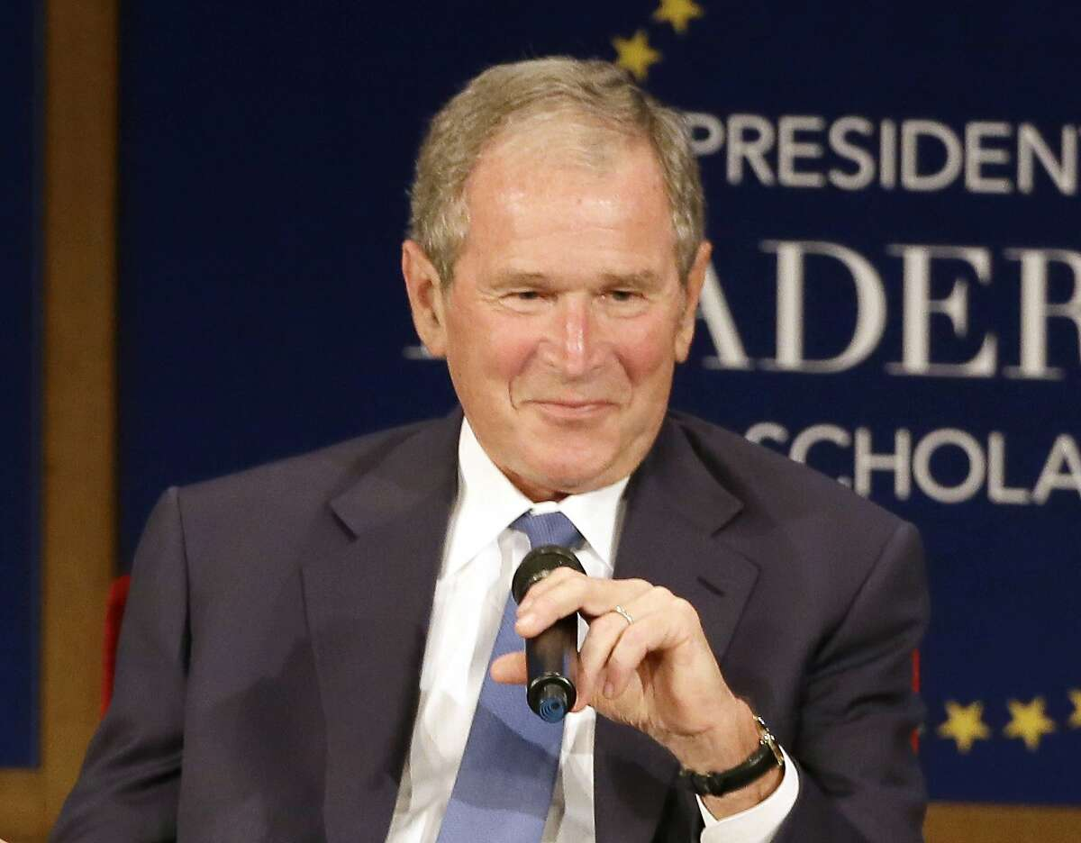 """FILE - Former President George W. Bush, appears during a discussion at the Presidential Leadership Scholars graduation ceremony at the George W. Bush Presidential Center in Dallas on July 13, 2017. Bush will honor American immigrants in a book coming out in March. Bush's """"Out Of Many, One: Portraits of America's Immigrants"""" includes 43 portraits by the 43rd president. (AP Photo/Tony Gutierrez, File)"""