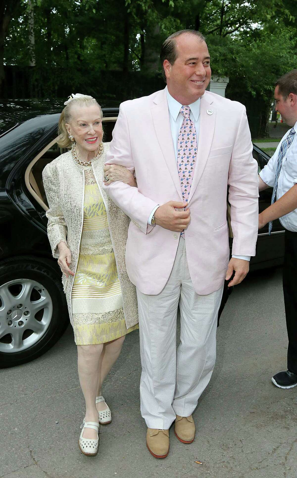 Saratoga Springs, NY - July 17, 2014 - (Photo by Joe Putrock/Special to the Times Union) - Philanthropist and prominent socialite Marylou Whitney(left) and her husband John Hendrickson(right) arrive at the 21st Annual Newton Plaza Siro's Cup to benefit the Center for Disability Services.