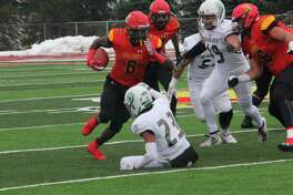 Tylor Minor (6) looks for running room during Ferris football action last season. (Pioneer file photo)