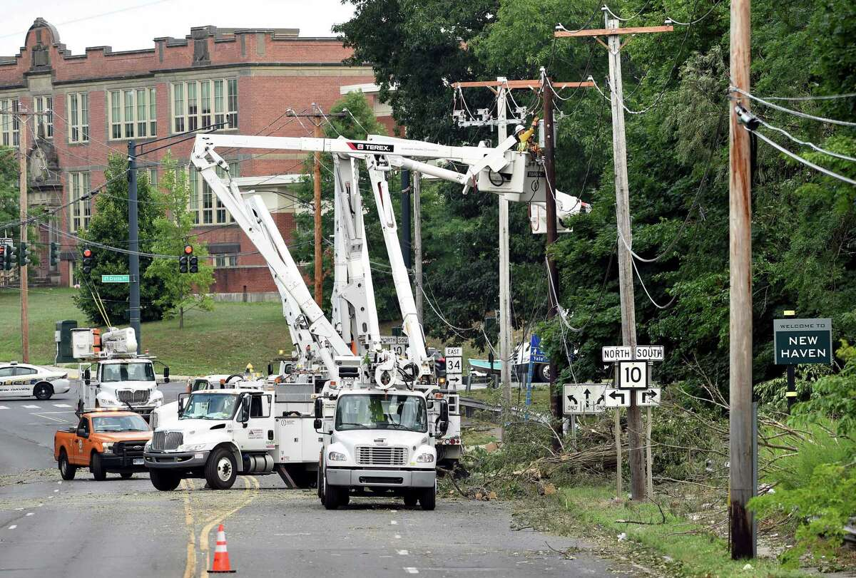 Utility crews work on electric lines on a closed section of Rt. 34 in New Haven on August 7, 2020.