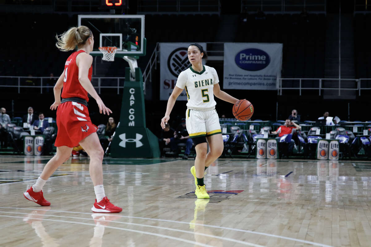 Deanna Winston of Siena dribbles in a game last season. She's taking her quarantine in stride. (Courtesy of Siena College Athletics)