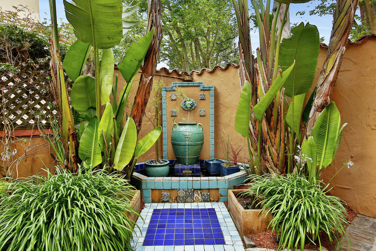 Tiled fountains are also a staple of Spanish-Med, and this home has a colorful example.