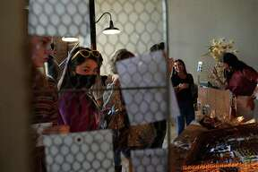 Event-goers socialize as they shop at the First Thursday Pop-Up event for area retailers at 434 Fannin Thursday. Seven local businesses joined in the event, as retailers find ever-creative means by which to keep their businesses alive amid the ongoing COVID-19 disruptions. Photo taken Thursday, August 6, 2020 Kim Brent/The Enterprise