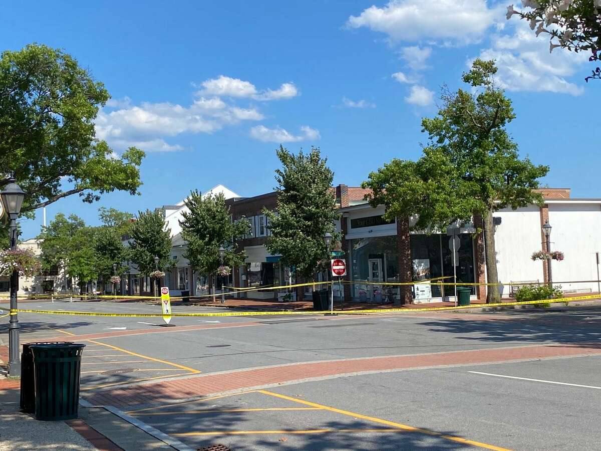 A transformer fire on Main Street in New Canaan closed parts of Main and Elm streets and South Avenue and Elm late Wednesday, Aug. 5, 2020. Elm was also closed from Main to South as police tape shows.