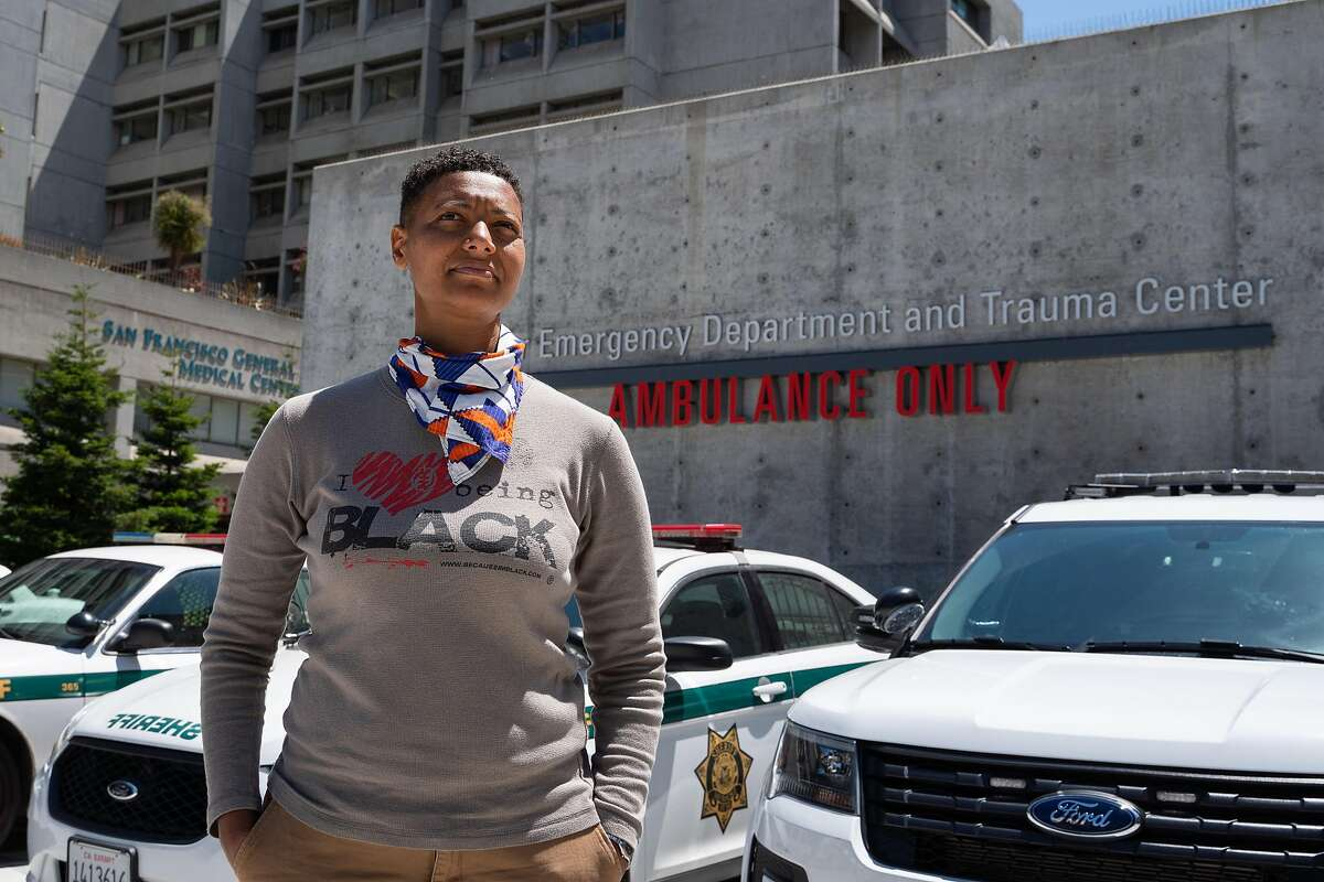 Jen Esteen, 39, of Ashland, poses for a photo outside of San Francisco General Hospital in San Francisco, Calif., on Thursday, August 6, 2020.