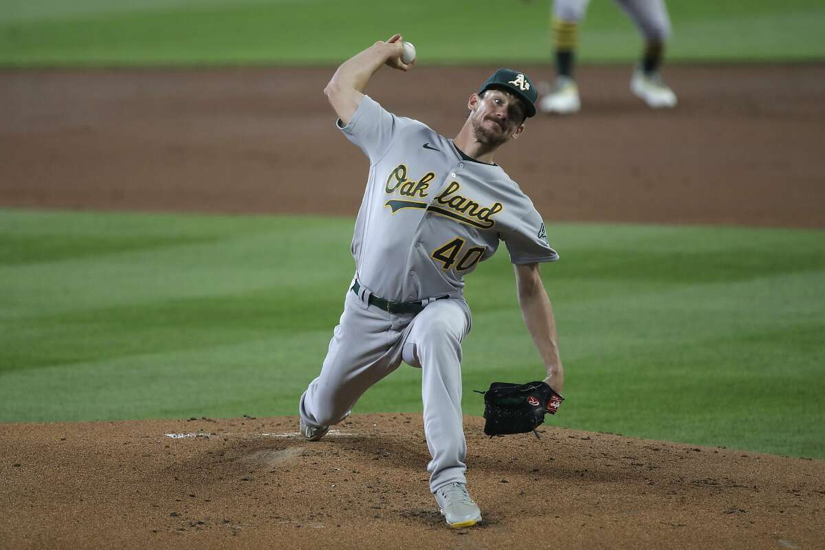 Oakland Athletics starting pitcher Chris Bassitt throws against the Seattle Mariners during the first inning of a baseball game, Sunday, Aug. 2, 2020, in Seattle. (AP Photo/Ted S. Warren)