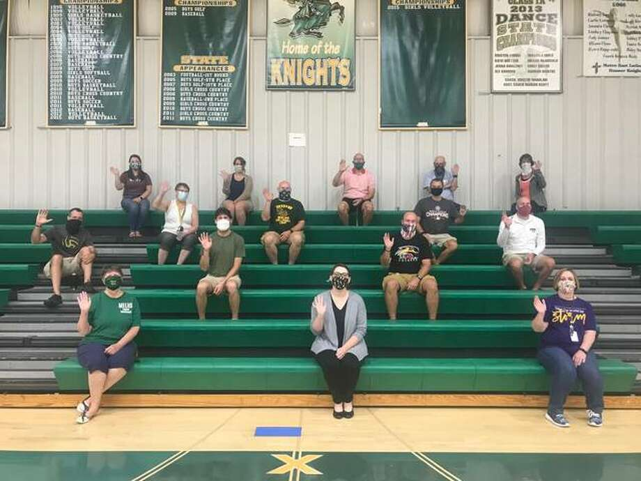 MELHS teachers sit socially distanced, waiving and waiting for the school year to begin. Photo: Courtesy Of MELHS