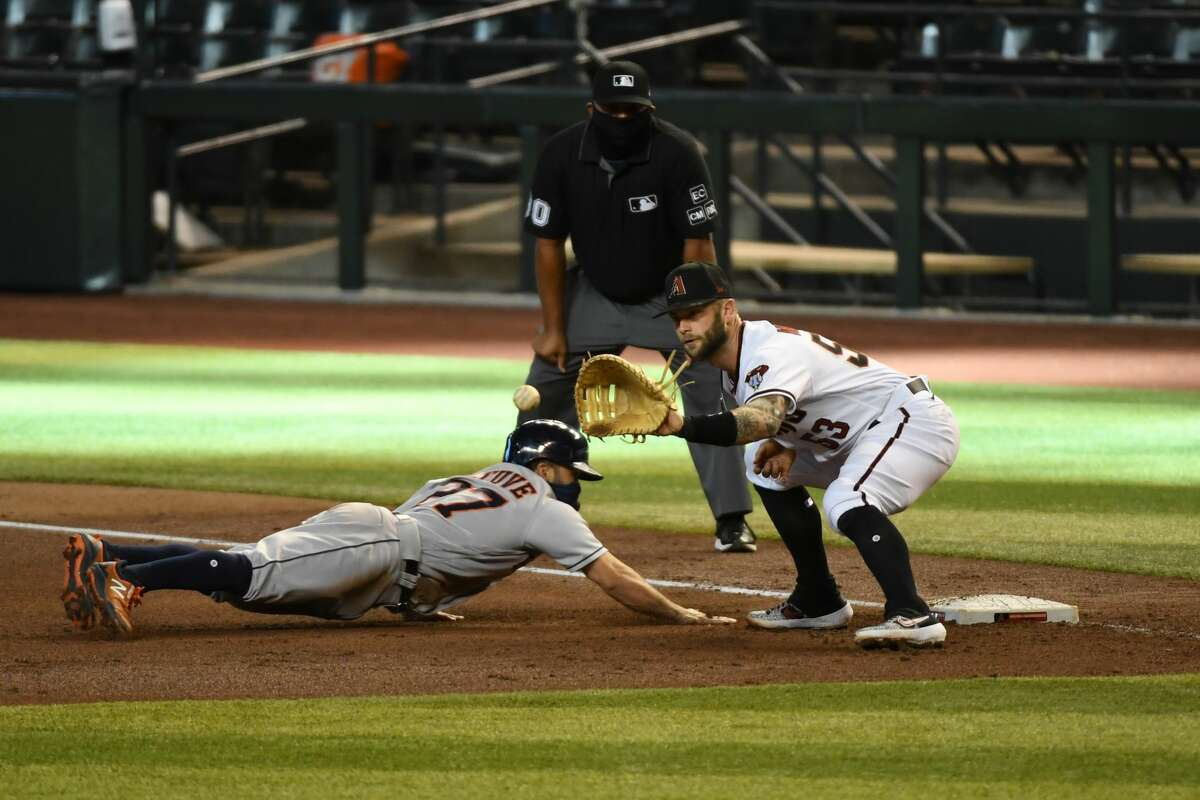 PHOENIX, ARIZONA - AUGUST 06: Jose Altuve #27 of the Houston Astros safely dives back to first base as Christian Walker #53 of the Arizona Diamondbacks waits for the throw from pitcher Zac Gallen #23 during the fourth inning at Chase Field on August 06, 2020 in Phoenix, Arizona. (Photo by Norm Hall/Getty Images)