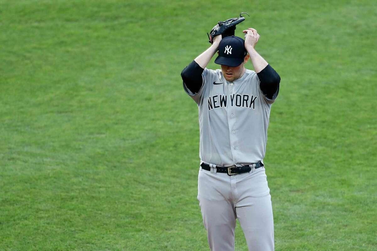 New York Yankees starting pitcher Jordan Montgomery adjusts his cap after walking Philadelphia Phillies' Rhys Hoskins during the first inning of a baseball game Thursday, Aug. 6, 2020, in Philadelphia. (AP Photo/Matt Slocum)