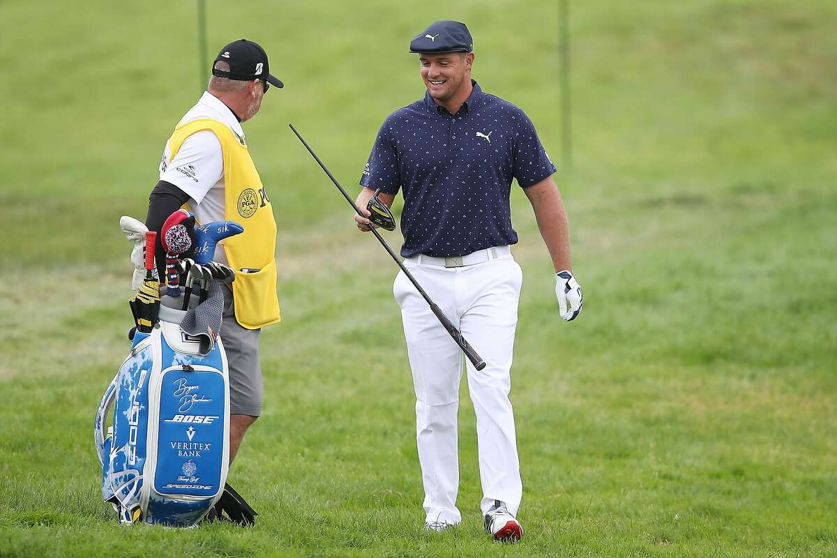 SAN FRANCISCO, CALIFORNIA - AUGUST 06: Bryson DeChambeau of the United States hands his broken driver to caddie Tim Tucker on the seventh hole during the first round of the 2020 PGA Championship at TPC Harding Park on August 06, 2020 in San Francisco, California. (Photo by Sean M. Haffey/Getty Images)