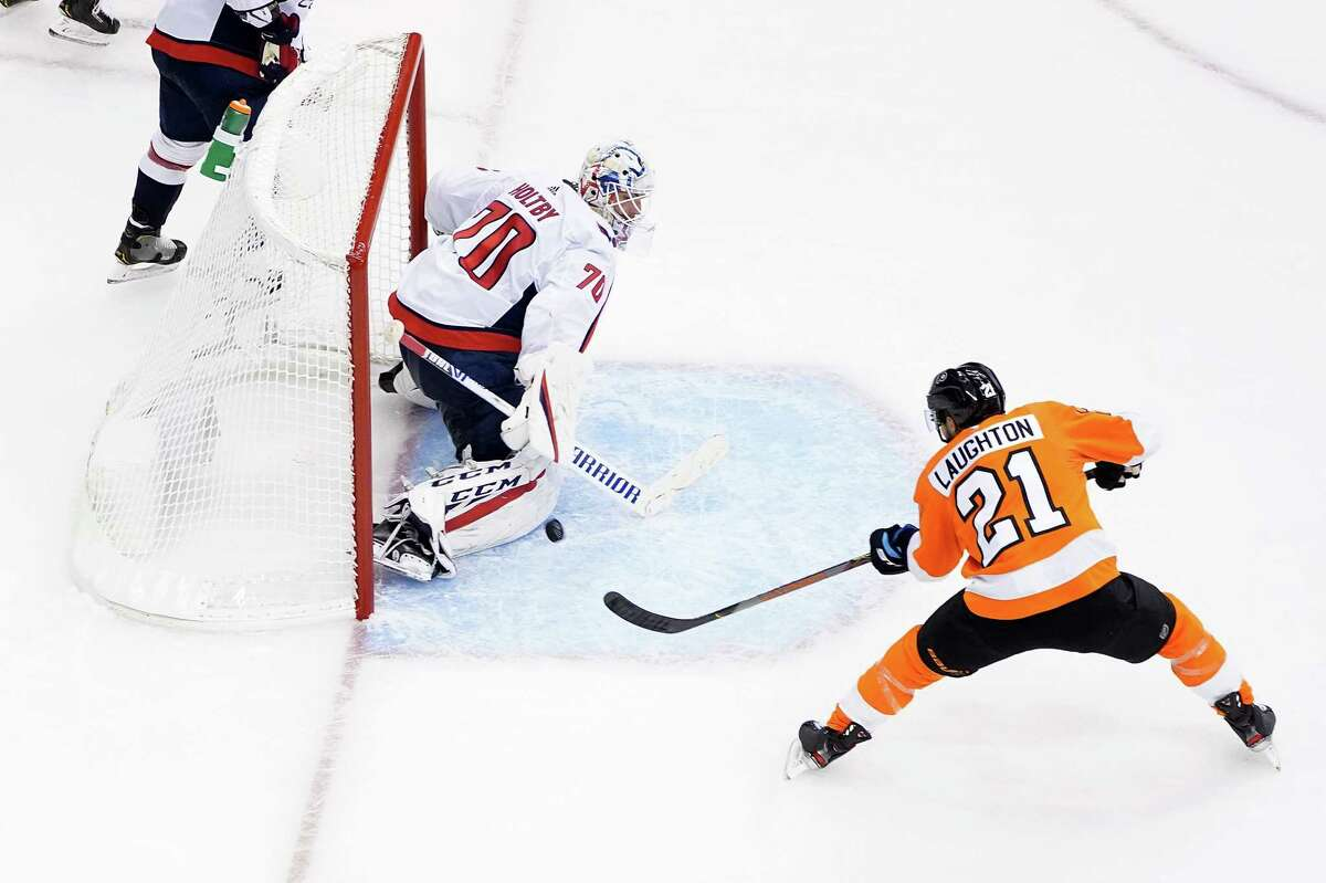 TORONTO, ONTARIO - AUGUST 06: Scott Laughton #21 of the Philadelphia Flyers scores a goal on Braden Holtby #70 of the Washington Capitals during the third period in the Eastern Conference Round Robin game during the 2020 NHL Stanley Cup Playoffs at Scotiabank Arena on August 06, 2020 in Toronto, Ontario, Canada. (Photo by Andre Ringuette/Freestyle Photo/Getty Images)