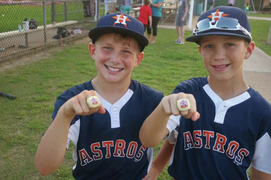 Leadoff batter Luke Rose (left) and three-hole hitter Gage Collins display their city championship rings Thursday night after the pair went 6-for-8, scored eight runs and tallied five RBIs in the 23-3 victory. Photo: Robert Avery