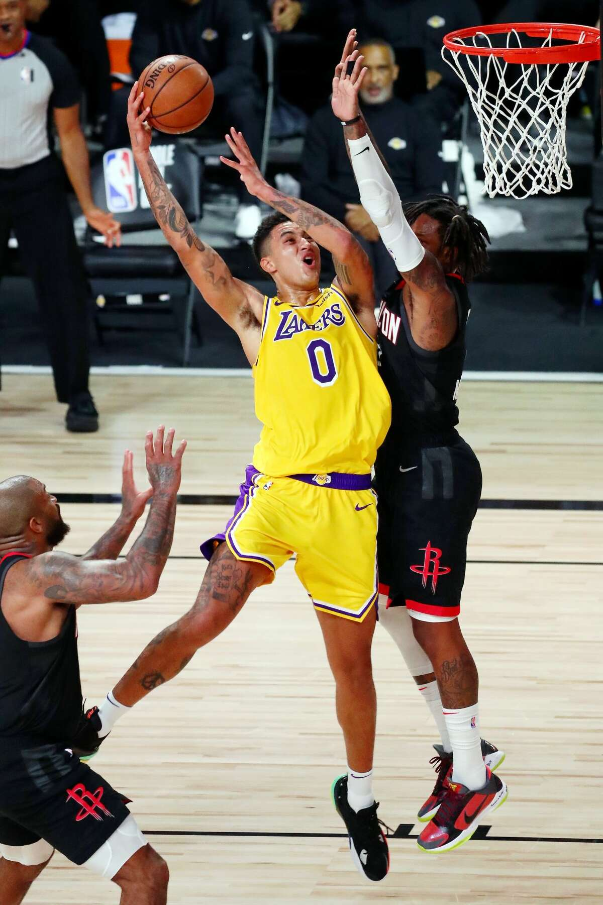 LAKE BUENA VISTA, FLORIDA - AUGUST 06: Ben McLemore #16 of the Houston Rockets fouls Kyle Kuzma #0 of the Los Angeles Lakers, who scored on the play in the first half at The Arena at ESPN Wide World Of Sports Complex on August 6, 2020 in Lake Buena Vista, Florida. NOTE TO USER: User expressly acknowledges and agrees that, by downloading and or using this photograph, User is consenting to the terms and conditions of the Getty Images License Agreement. (Photo by Kim Klement-Pool/Getty Images)