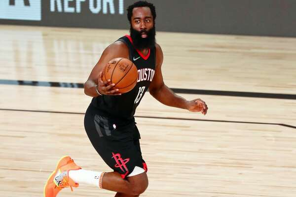 James Harden #13 of the Houston Rockets brings the ball up court against the Los Angeles Lakers in the second half at The Arena at ESPN Wide World Of Sports Complex on August 6, 2020 in Lake Buena Vista, Florida. (Photo by Kim Klement-Pool/Getty Images)