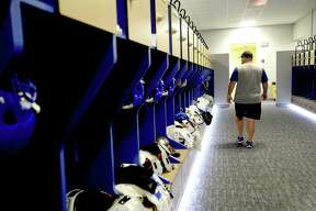 A coach walks past the locker room renovations at Hamshire - Fannett High School, which were completed Wednesday, August 5. Although the large pulic reveal party Hollman, Inc., had planned for the grand finale was canceled due to COVID-19, a small group of athletes were able to get a view of the final product Thursday during a private viewing. Hollman's Tia Williams says she and work crew have barely slept as they worked to complete the locker rooms in time for the start of the school year amid a global pandemic. They, like coaches and athletes, just hope that students are able to put the locker rooms to use as school begins amid uncertainty and ongoing case reports. Photo taken Wednesday, August 5, 2020 Kim Brent/The Enterprise