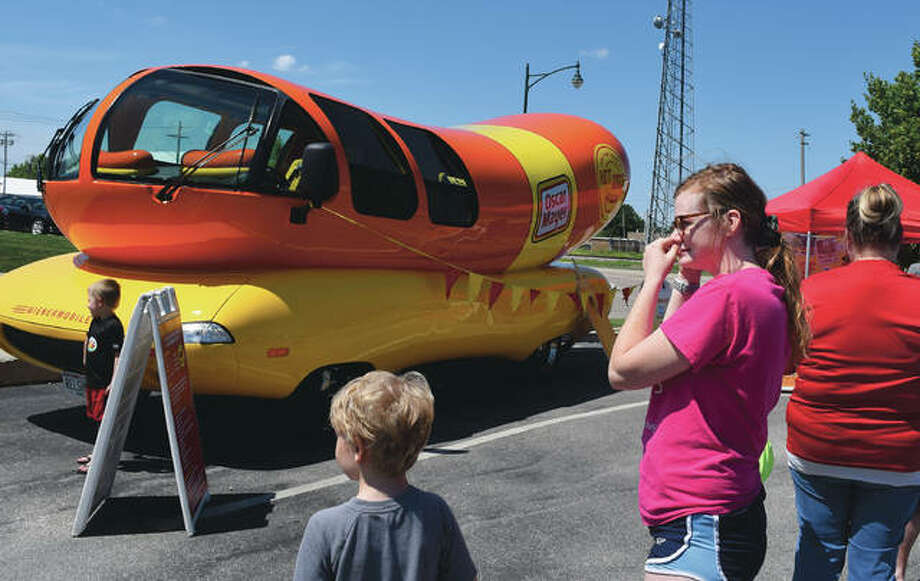 The Oscar Mayer Wienermobile makes a stop Thursday Charlie's Ice Cream in Jacksonville. Photo: Rochelle Eiselt | Journal-Courier