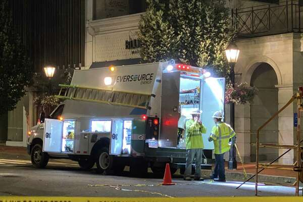 Eversource underground crews worked overnight a transformer fire under Elm Street Wednesday, Aug. 4. Line crews were arriving in town Friday to restore power cut by Tropical Storm Isais.