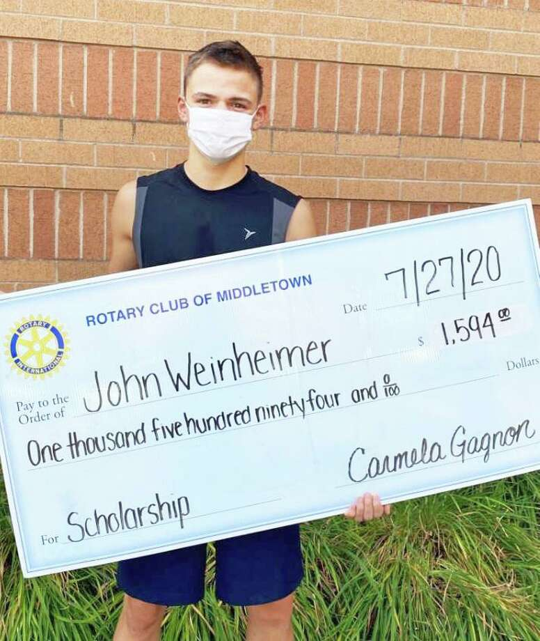 Middletown Rotary Club scholarship winner John Weisenheimer received a $1,594 check. Photo: Contributed Photo