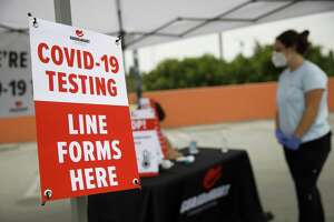 Covid-19 testing signage is displayed at a GUARDaHEART Foundation site in Los Angeles, California, on Aug. 5, 2020.