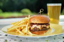 Victoria Blamey is chef-in-residence this summer at the Mayflower Inn & Spa, Auberge Resorts Collection, in Washington, Conn. The celebrated chef has come up with new menus, including Tap Room dishes that are rustic yet refined. Among them is this burger served with a mango BBQ sauce, American cheese, bone marrow and crispy fried shallot.