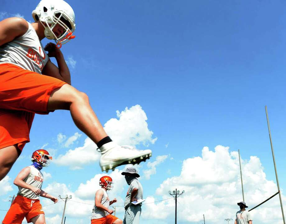 Orangefield varsity get in practice Monday, the first day smaller class schools were allowed to resume sport practices under latest UIL guidelines.  Photo taken Monday, August 3, 2020 Kim Brent/The Enterprise Photo: Kim Brent / The Enterprise / BEN