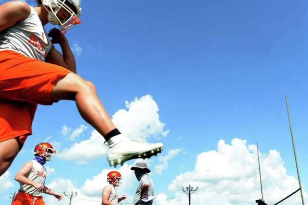 Orangefield varsity get in practice Monday, the first day smaller class schools were allowed to resume sport practices under latest UIL guidelines. Photo taken Monday, August 3, 2020 Kim Brent/The Enterprise