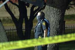 A 19-year-old woman was shot after a group of men opened fire at a North Side apartment complex Friday morning.