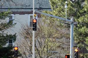 Three traffic lights signal traffic to stop at the end of the one way, one lane 6th Street in Stamford, Conn. Monday, March 18, 2018.