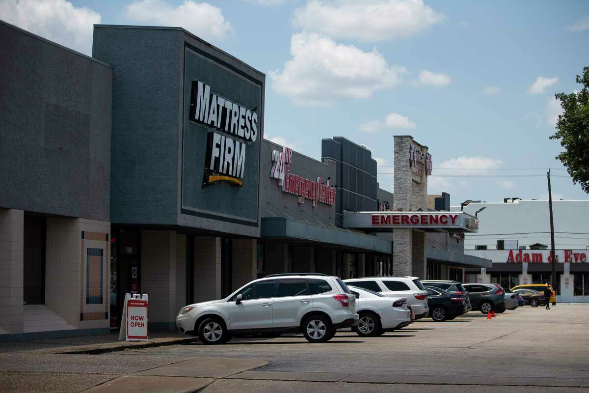 Property on the southwest corner of Montrose Boulevard and Westheimer Road that includes a Mattress Firm and a Half Price Books was recently purchased by residential towers rise up just south of the Skanksa USA , Wednesday, Aug. 5, 2020, in Houston. The company paid $27 million and says it will build a retail and residential project on the site.